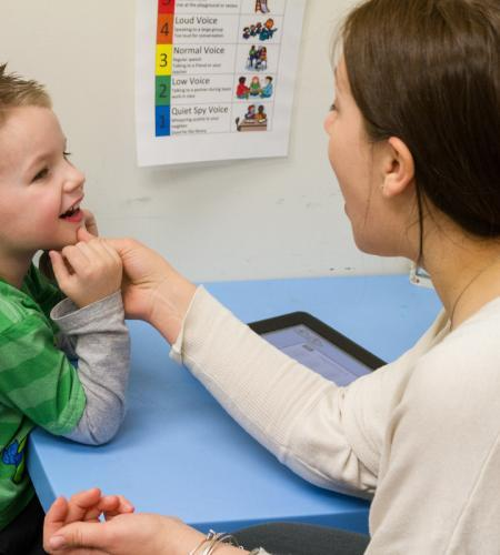 A child during a session with a speech and language pathologist.