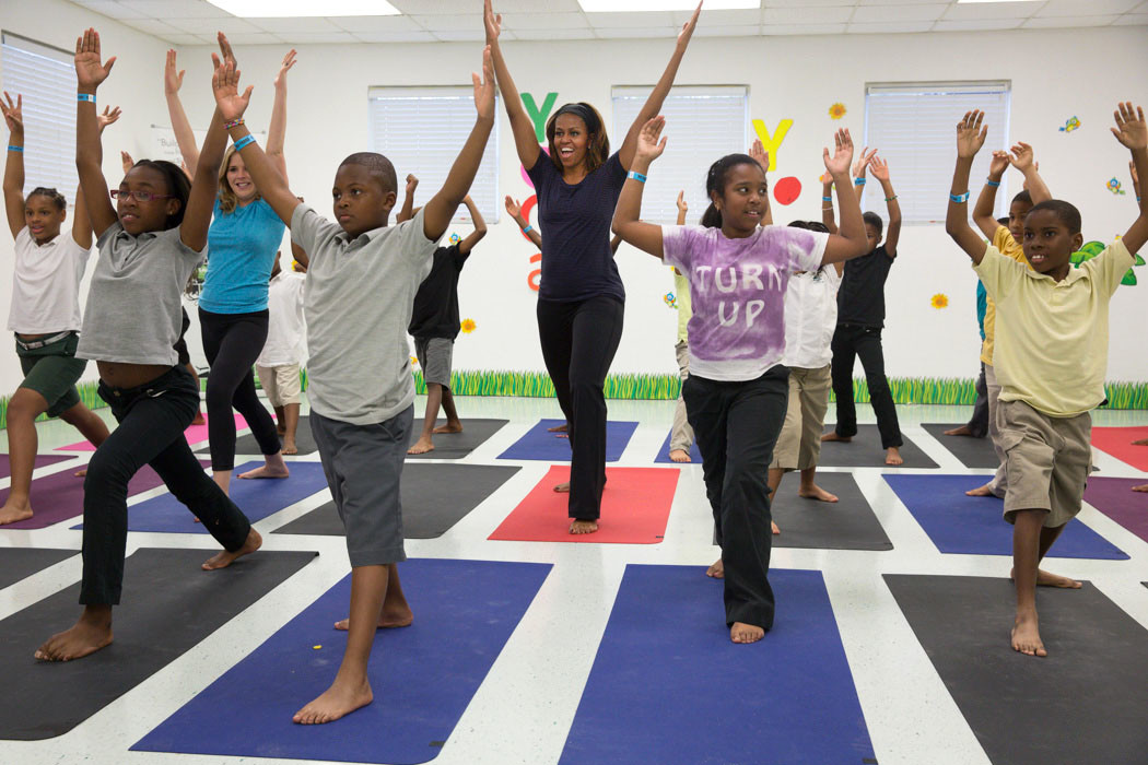 First Lady Michelle Obama participates in yoga with Jenna Bush and kids