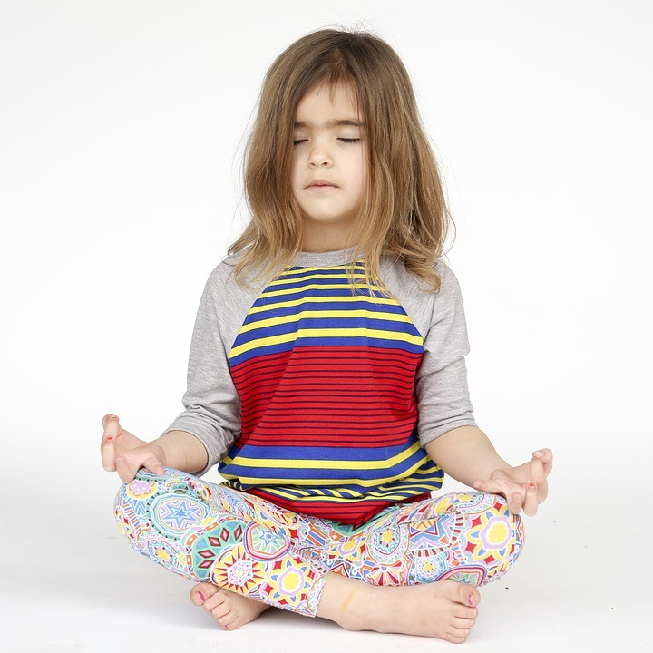 a young girl doing yoga