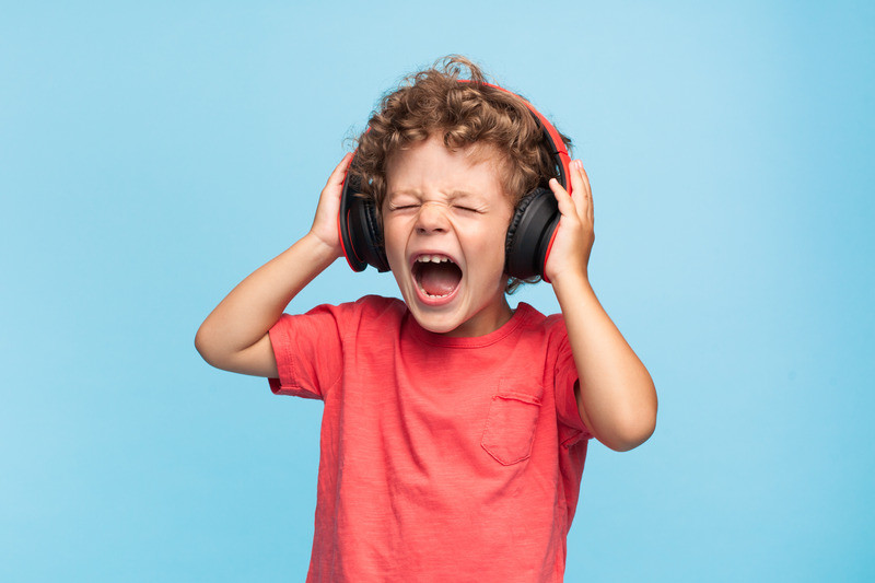 boy wearing headphones listening to loud music