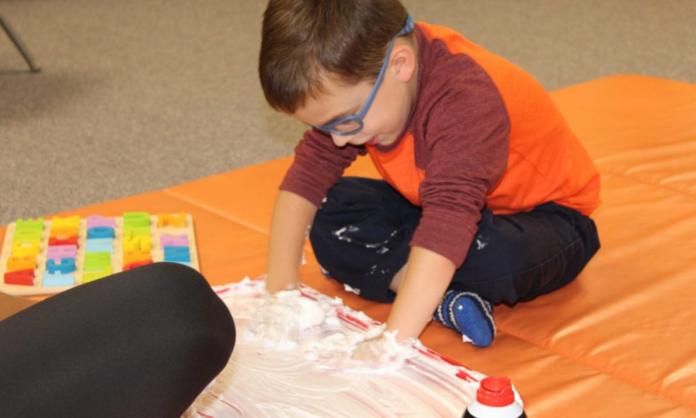 child playing with a tactile item