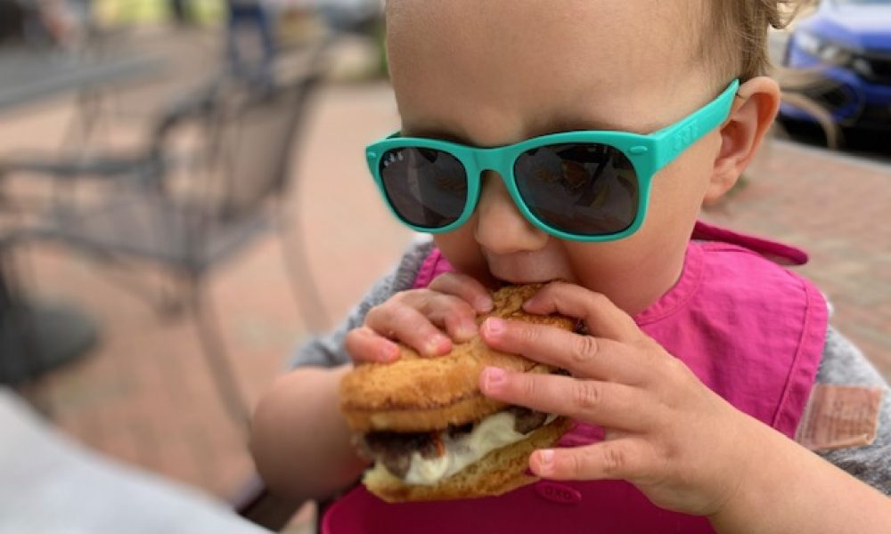Child biting into a multi-textured food