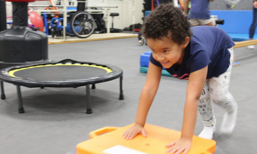 child animal crawling to benefit her core strength, while having fun