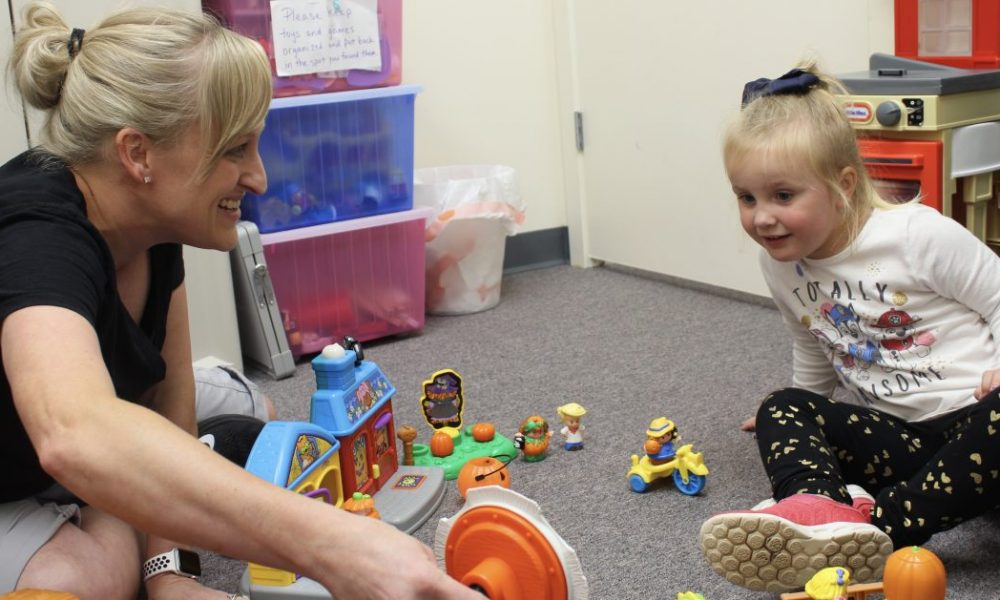 Speech therapist engaging in play based therapy