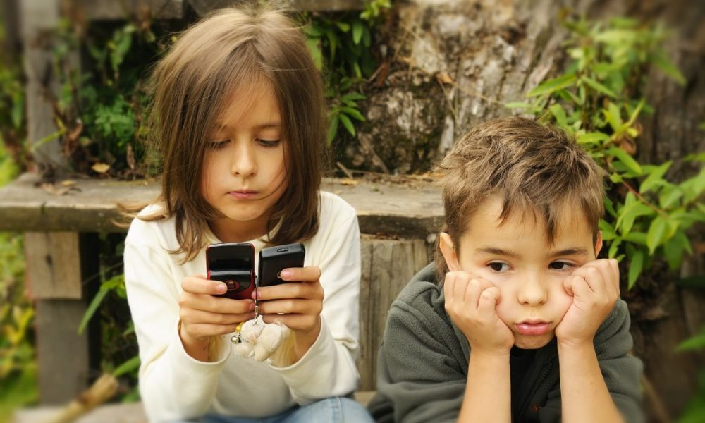 kids  playing in a  mobile phone